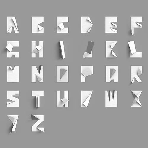 the folded paper alphabet i love simple brilliant designs like this it makes me want to get out my scissors and try it for myself datz1