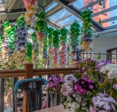 Dining Under a Sea of Paper Flowers