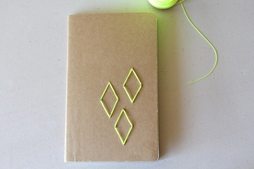 Those plain brown notebooks are perfect for decorating. I love this geometric embroidered one.