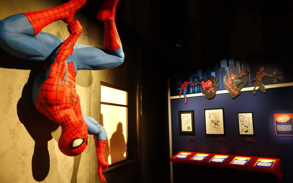 A Spider-man statue and various pieces of Spider-Man art.