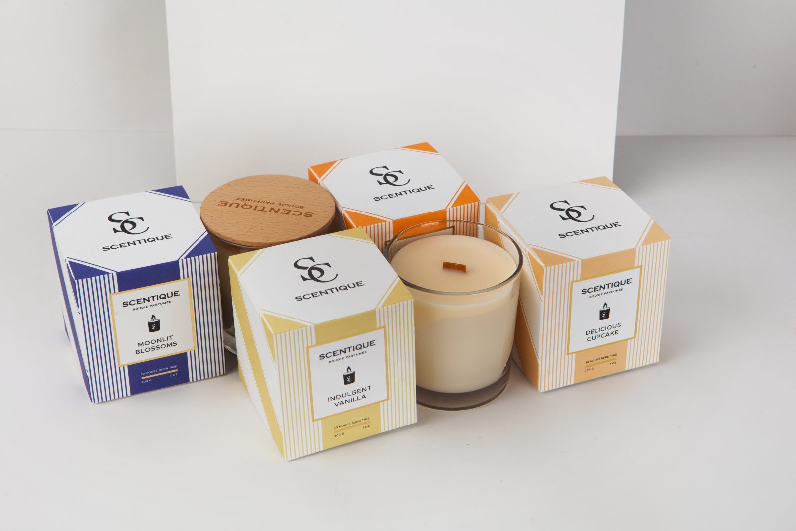 Scentique's Elegant Candle Packaging By The Offset Group